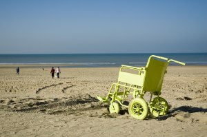painted wheelchair on dutch beach